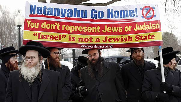 Pro- and anti-Netanyahu protesters cry out from Capitol Hill