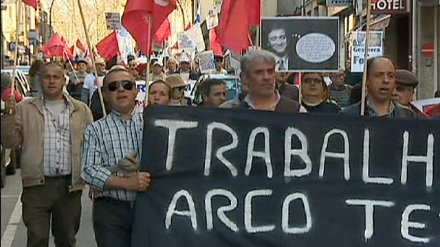 Thousands protest austerity in Portugal as PM mired in tax scandal