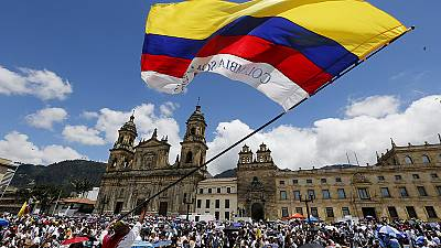 Colombians march in support of peace talks to end civil war