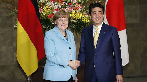 Visiting Merkel reminds Japan to confront wartime past