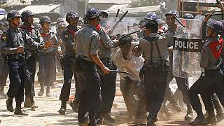 Student protesters clash with riot police in Myanmar