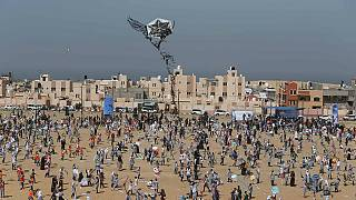 Palestinian children fly kites to mark anniversary of Japan Tsunami