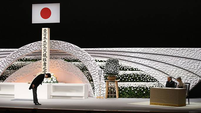В Японии минутой молчания почтили жертв катастрофы четырёхлетней давности