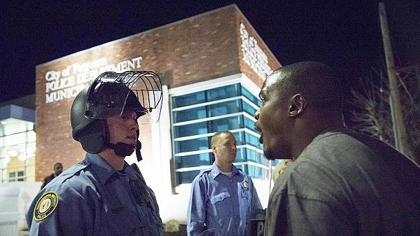 Ferguson: Police officers conscious, but mixed reports on location of shooter