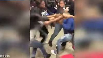 Video of vicious teenage beating as crowd looks on goes viral in US