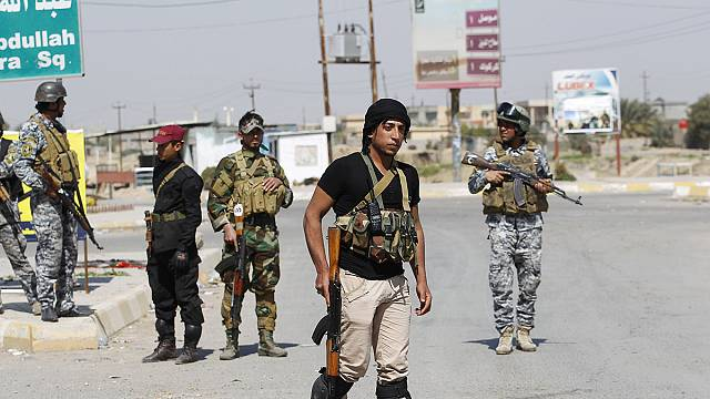 Shi'ite militia and Iraqi troops continue push for Tikrit