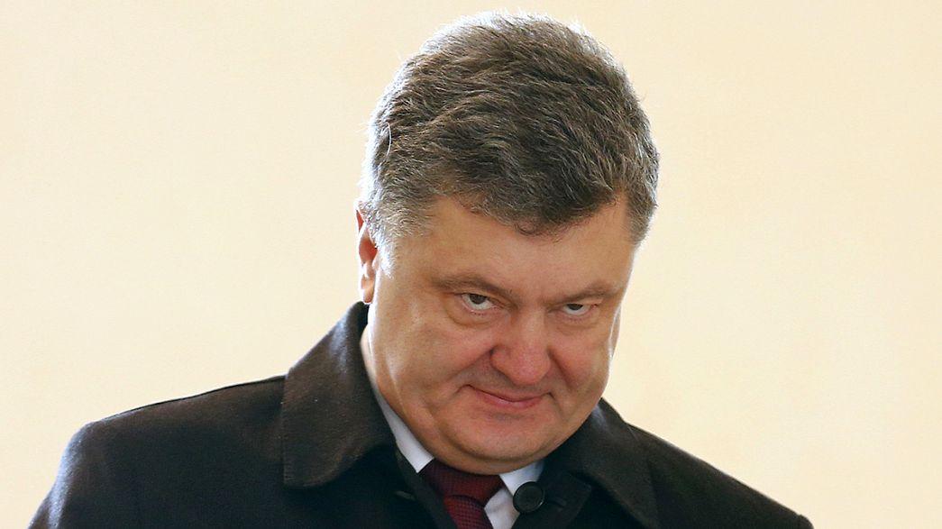 Poroshenko visita Merkel
