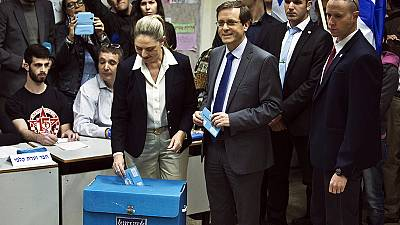 Israel goes to polls in tight election contest