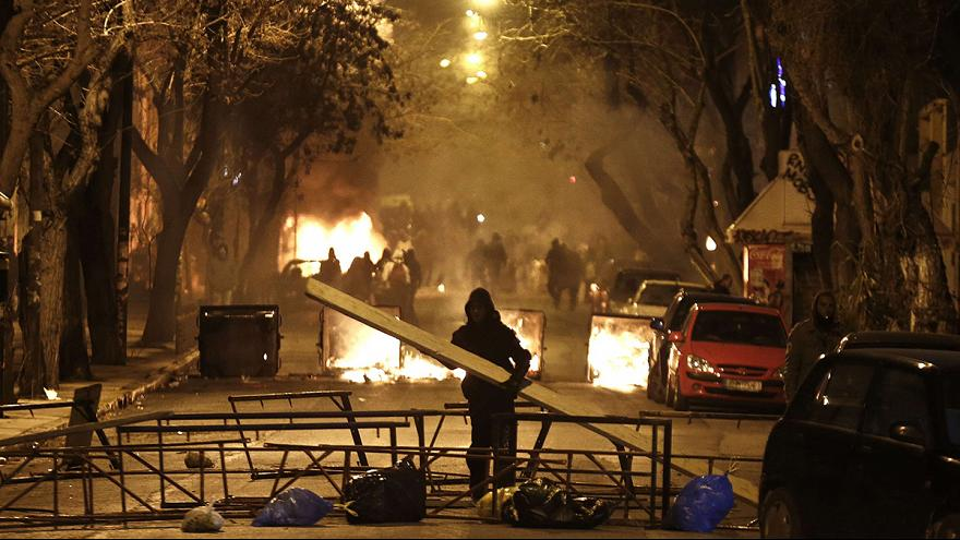 Hooded anarchists clash with Greek riot police in Athens