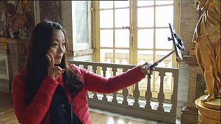 Selfie stick use splits France's cultural capital