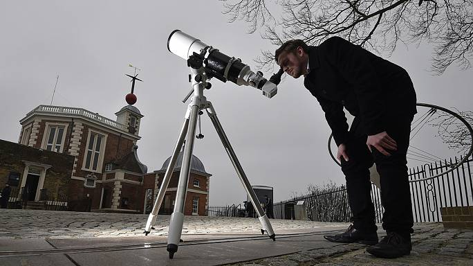 Fending off polar bears and freezing temperatures eclipse hunters flock North