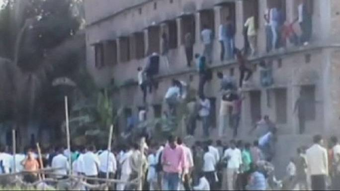 Reaching new heights: Parents in India scale walls to 'help students cheat'