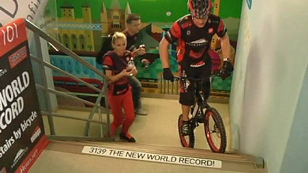 Record-breaking cyclist steps up to the plate