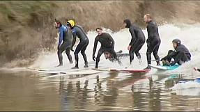 Surfers enjoy rare river wave