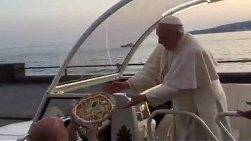Pizza for the Pope as he's handed a drive-by delivery in Naples