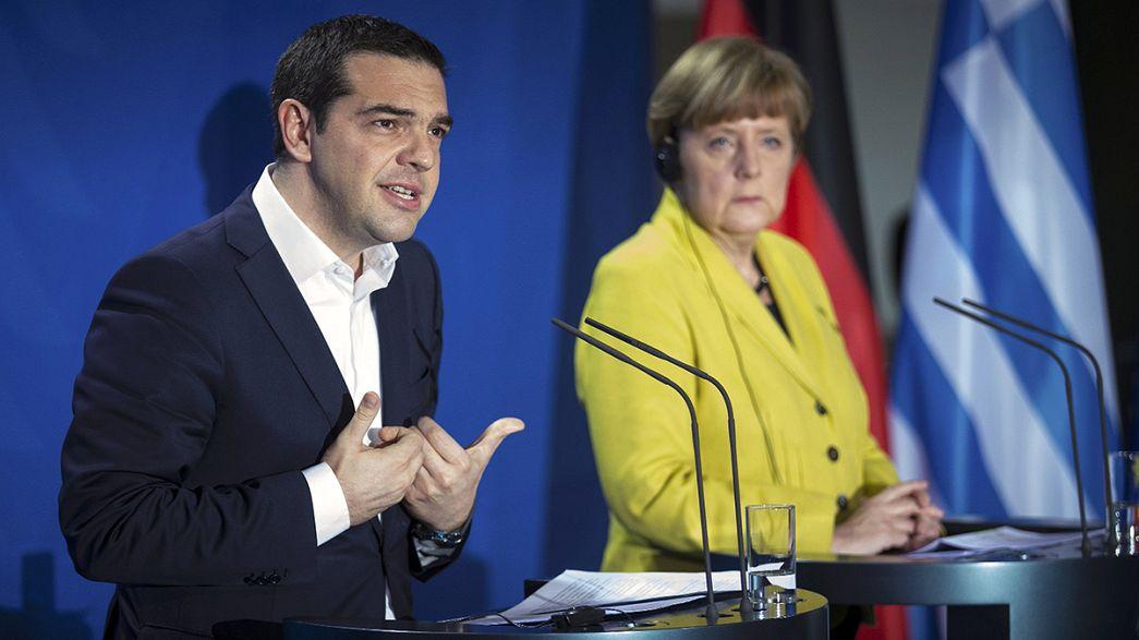Merkel y Tsipras tienden la mano a la cooperación y el diálogo