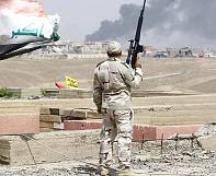 Iraqi forces reclaim government headquarters in battle for Tikrit