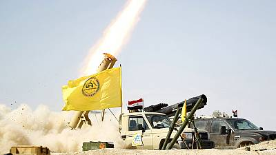 Iraqi soldiers and Shi'ite militia celebrate victory in Tikrit