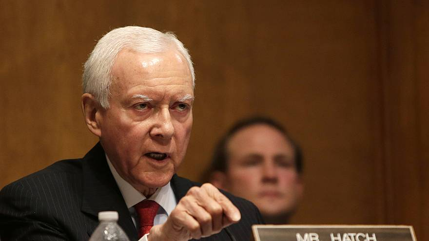 Image: Senator Hatch questions witnesses during testimony at the Senate Fin
