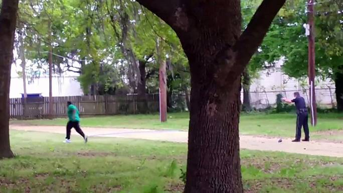 U.S. police officer charged with murder for shooting black man
