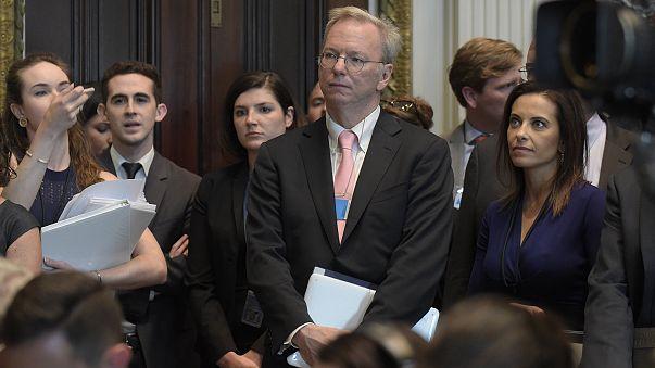 Image: Eric Schmidt  listens as White House senior adviser Jared Kushner sp