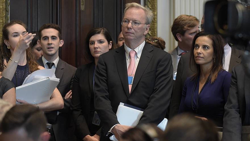 Image: Eric Schmidt  listens as White House senior adviser Jared Kushner sp