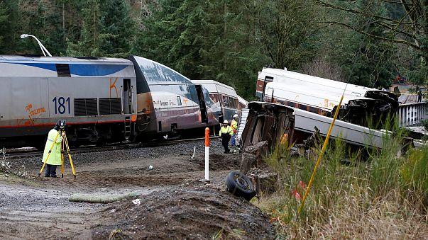 Image: Investigators begin analysis at the scene where an Amtrak passenger