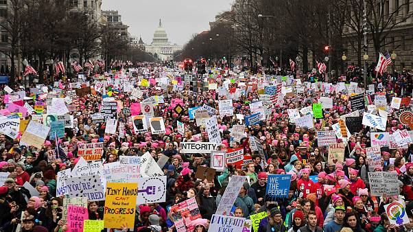 Image: Hundreds of thousands march down Pennsylvania Avenue during the Wome