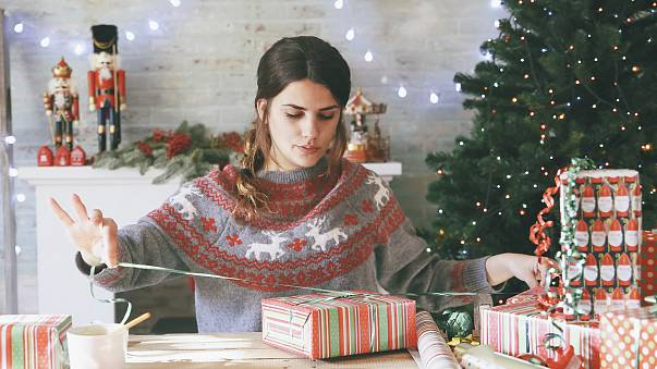 Image: Woman wrapping Christmas gifts