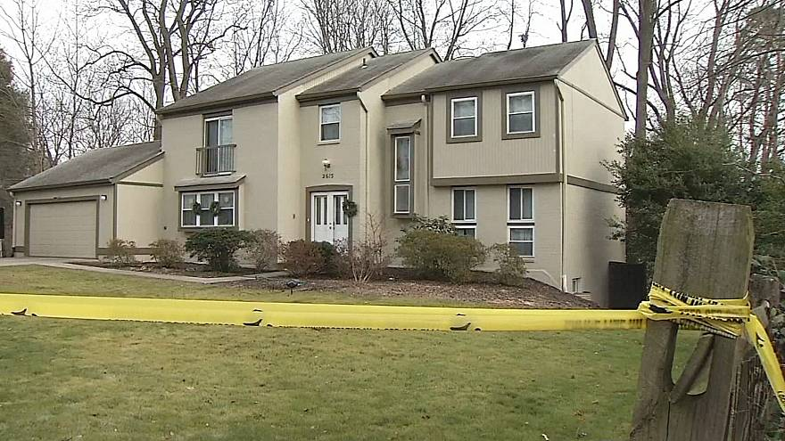 Image: Image: Crime scene tape outside the home of Scott Fricker and his wi