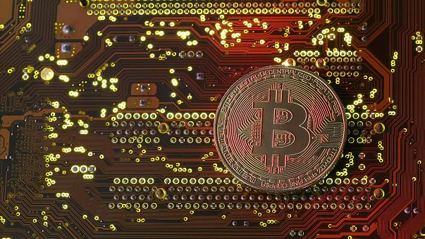 Image: A bitcoin illustration on a motherboard on Oct. 26, 2017.