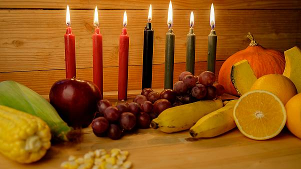 Kwanzaa holiday concept with decorate seven candles red, black and green, g