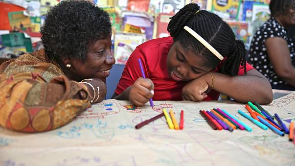 Image: Dr. Claudette Crawford-Brown interacts with Shaniqua Long