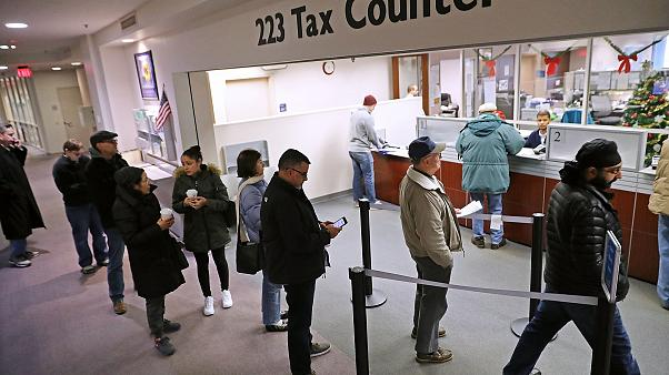Image: Taxpayers Line Up To Pre-Pay Property Taxes Ahead Of New Tax Law Lim