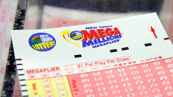Image: A ticket is seen ahead of the Mega Millions lottery draw which reach