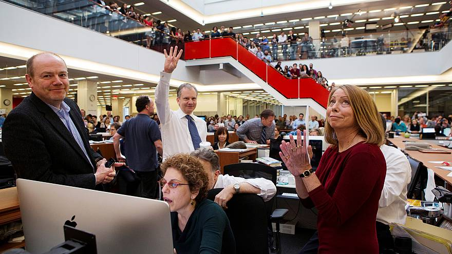 Image: In 2013, publisher Arthur O. Sulzberger Jr. holds up four fingers to
