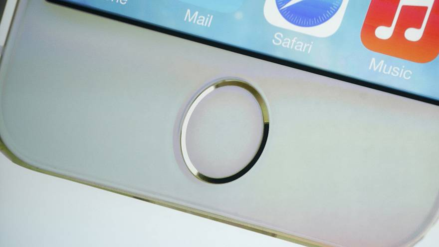 The home button which doubles as a fingerprint sensor is seen on an image o