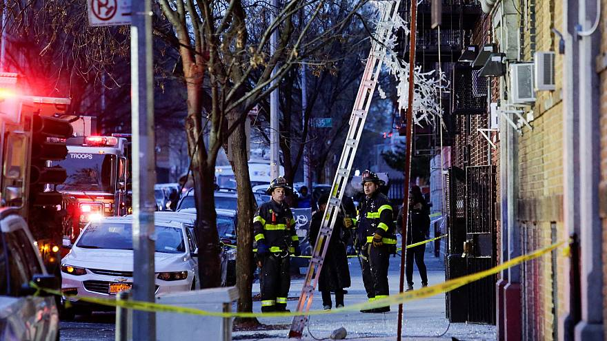 Image: Fire Department of New York (FDNY) personnel work on the scene of an