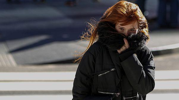 Image: A Woman Bundles Up Against the Cold Temperature