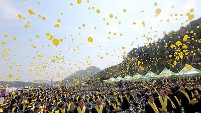 South Korea's president vows to raise Sewol ferry on first anniversary of disaster
