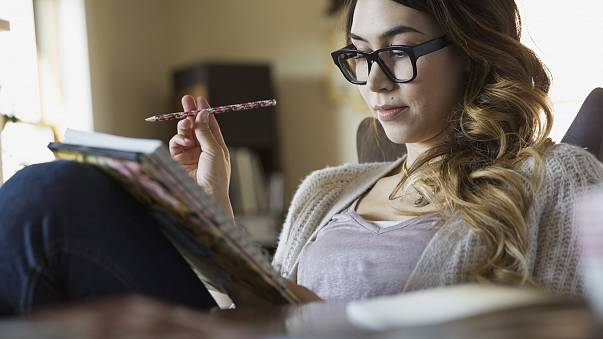 Image: Woman writing in notebook
