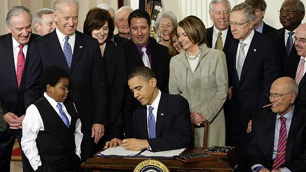 Image: President Barack Obama signs the health care bill in the East Room o