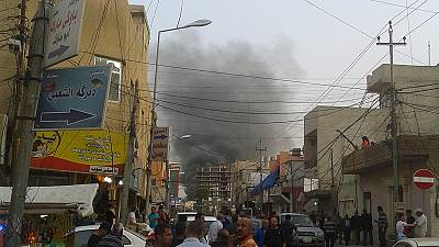 A deadly day in Iraq: Three car bombs in two cities kill at least 30