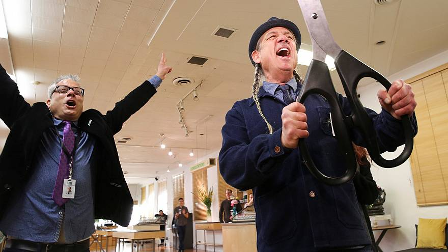 Image: Andrew and Steve DeAngelo celebrate after a ceremonial ribbon cuttin