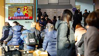 Image: South Koreans in Seoul's main train station watch Kim Jong Un addres