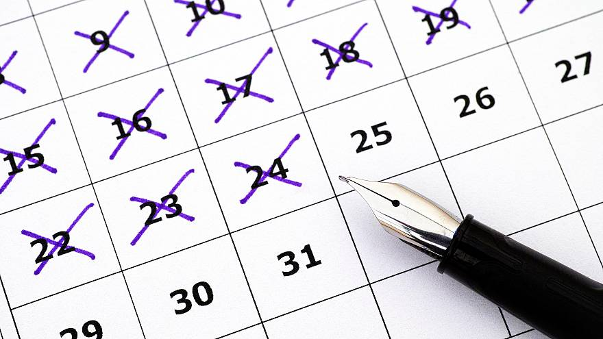 Image: Fountain pen lying on calendar with marking days