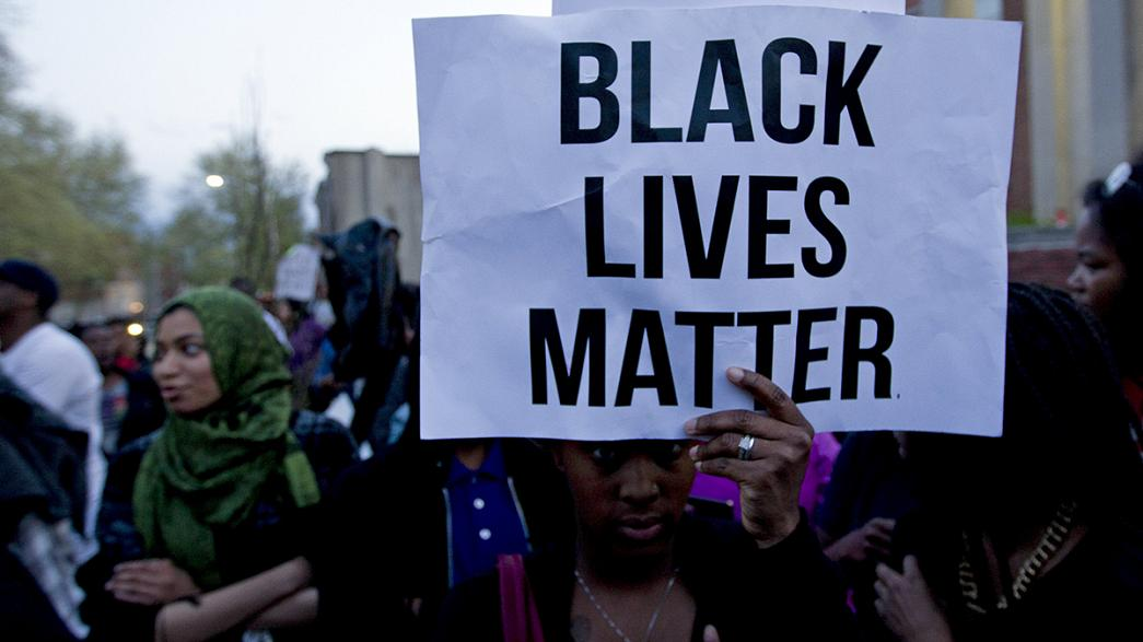 Crowds protest over death of black man arrested by Baltimore police