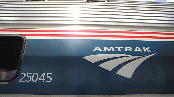 Image: An Amtrak train waits at a station