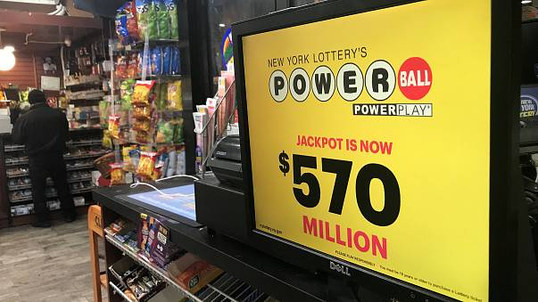 Image: A Powerball sign is pictured in a store in New York City
