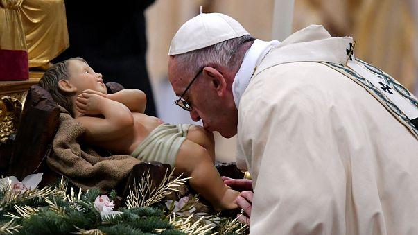 Image: TOPSHOT-VATICAN-POPE-MASS-EPIPHANY